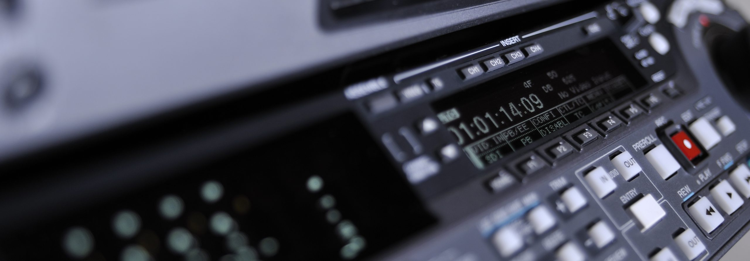 Close-up of the front panel of the professional digital betacam video recorder.  Shallow dof. Displays, equalizer, buttons.